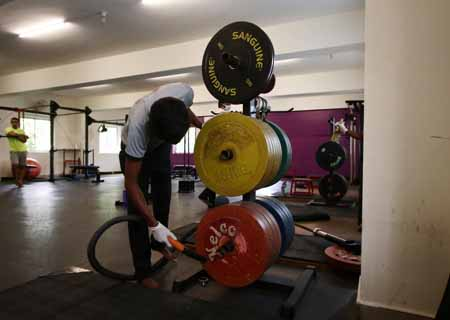 Chennai: Workout equipments being sanitised at a gym as it gears up to reopen for people amid COVID-19 pandemic as part of Unlock 3.0, in Chennai on Aug 6, 2020. (Photo: IANS)