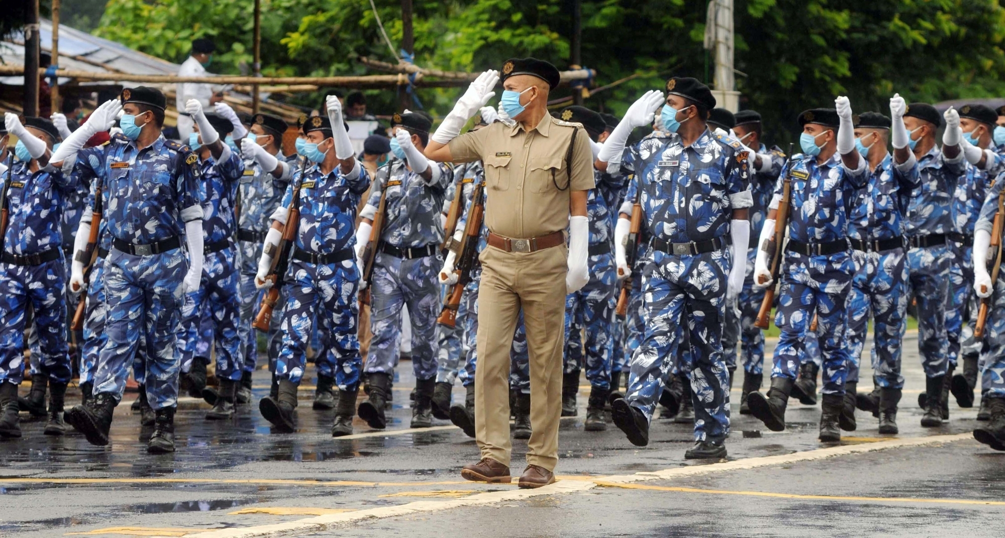 Kolkata : Kolkata police department wearing face masks, take part in a rehearsal ahead of the upcoming Independence Day parade at Red Road, in Kolkata on Aug 09, 2020. (Photo: IANS)