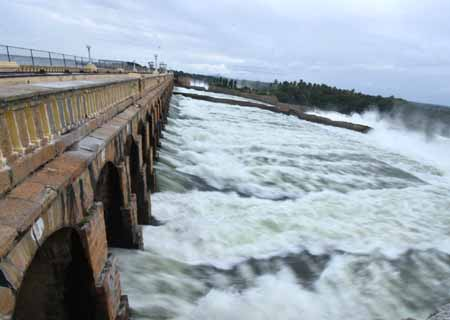 Mandya: 70,000 cusecs of water released from KRS reservoir after an inflow of 77848 cusecs was reported, in Mandya district of Karnataka on Aug 8, 2020. (Photo: IANS)