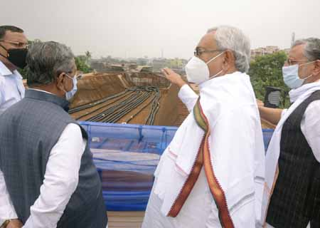Patna: Bihar Chief Minister Nitish Kumar with Deputy CM Shusheel Kumar Modi and RCD Minister Nand Kishore Yadav seen inspecting a construction site, in Patna on August 9, 2020. (Photo: IANS)