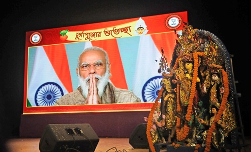 Kolkata: Prime Minister Narendra Modi virtually inaugurated Durga Puja celebrations jointly organised by the BJP Mohila Morcha and the party's Cultural cell at Salt Lake City in Kolkata on Oct 22, 2020. (Photo: Kuntal Chakrabarty/IANS)
