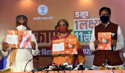 Patna: Union Finance Minister Nirmala Sitharaman, BJP Bihar In-charge Bhupendra Yadav and state party president Sanjay Jaiswal release the party election manifesto ahead of Bihar Assembly polls, in Patna on Oct 22, 2020. (Photo: IANS)