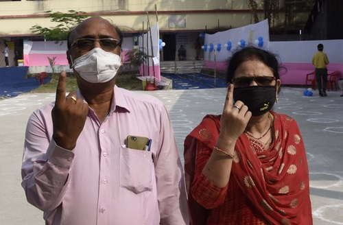 Patna: Voters show their inked fingers after casting their votes for Bihar Legislative Council elections, in Patna on Oct 22, 2020. (Photo: IANS)
